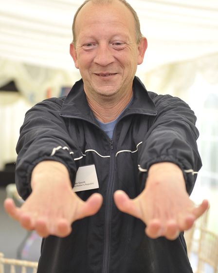 Dean Gould, the world record holder of beermat flipping, shows how flexible his hands are