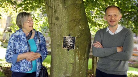 Cynthia Robinson and her son Mike with the newly installed plaque in 2019 which has recently been stolen from Long Sutton