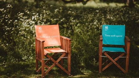 Two chairs in long, wavy grass: the National Trust