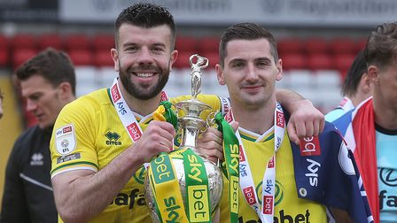 Grant Hanley of Norwich and Kenny McLean of Norwich with the EFL Championship trophy at the end of t