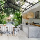 Open kitchen with dining room table and chairs outside