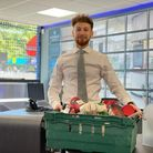 Dario from Martyn Gerrard estate agent's with a food bank collection box for Food Bank Aid