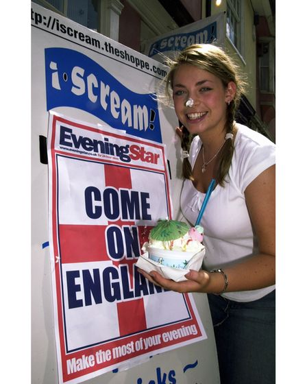 Katie McCall at i-scream in Ipswich with an Evening Star poster ahead of the England-Croatia match in 2003