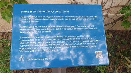 A plaque installed to re-contextualise The Museum of the Home's Geffrye statue.