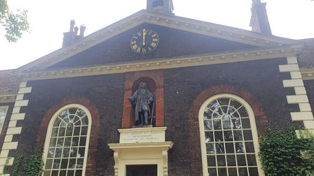 The statue of Sir Robert Geffrye features prominently on one side of the museum's building.
