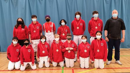 Newham Swords medalists from the Newham Junior Foil tournament with Linda Strachan and Pierre Harper