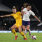 Australia's Steph Catley (left) battles with England's Lucy Staniforthduring an international friendly at Craven Cottage