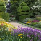 Colourful summer borders in the gardens at Nymans, West Sussex.