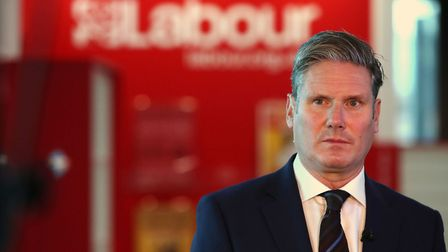 Labour's Keir Starmer speaks with the media at a party conference. Photograph: Peter Byrne/PA.