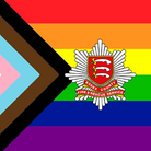 The Progress Pride flag. In the middle: Essex County Fire and Rescue Service's logo