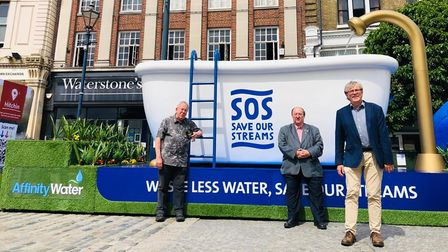 Cllrs Keith Hoskins, Paul Clark and Steve Jarvis at Affinity Water's SOS bathtub in Market Place, Hitchin
