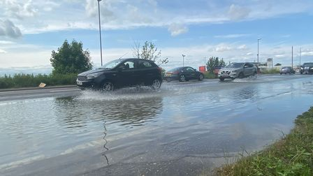 Traffic delays on Caister Road due to a burst water main.