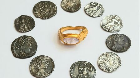 The Roman gold ringset with an amethystand the collection of Roman silver coins