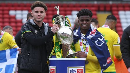 Josh Martin of Norwich and Bali Mumba of Norwich with the EFL Championship trophy at the end of the