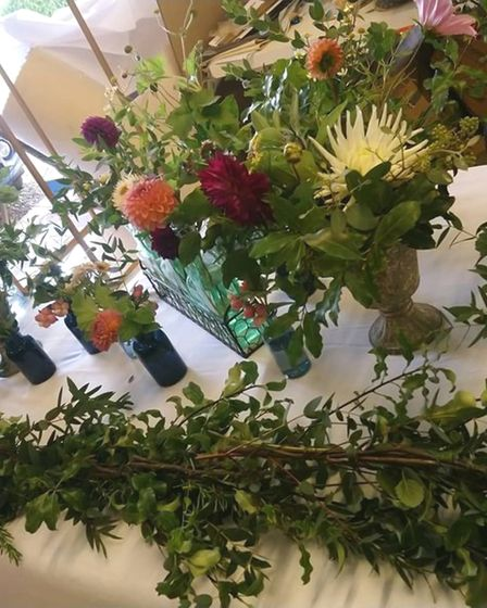 Floral displays being prepared for a wedding
