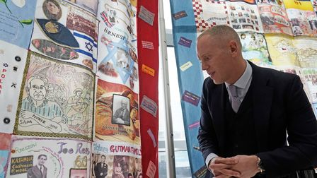 Robert Rinder, ITVÕs 'Judge Rinder, looks at a photo of his grandfather, Moishe Malenicky, one of th