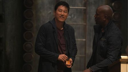 Han (Sung Kang) and Roman (Tyrese Gibson) in Fast & Furious 9.