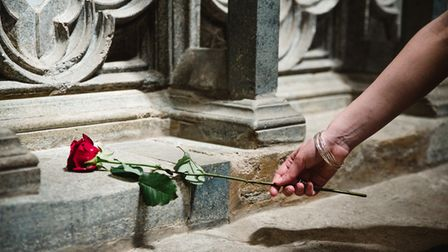 Laying a red rose for Alban at St Albans Cathedral.