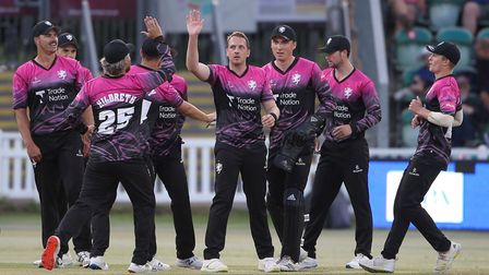 Josh Davey of Somerset celebrates with his team mates after taking a wicket in theVitality Blast T20