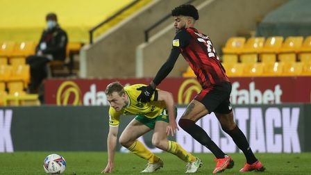 Oliver Skipp of Norwich and Philip Billing of Bournemouth in action during the Sky Bet Championship