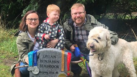 (Left to right) Bryony Seabrook, of Sprowston, with son Jenson, husband Ben, and family dog Barney, at son Dylan's headstone