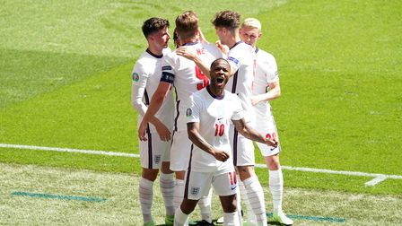 England's Raheem Sterling celebrates scoring their side's first goal of the game with team-mates dur