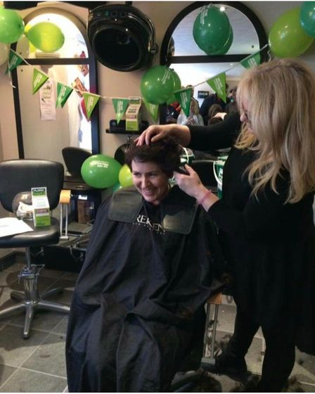 Woman having her head shaved for charity