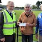 Clevedon Town chairman Brian Rose (left) receives a cheque from Steve Malloy and John Brookes in September 2020