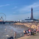People enjoy the sunshine at Blackpool beach, as Bank Holiday Monday could be the hottest day of the