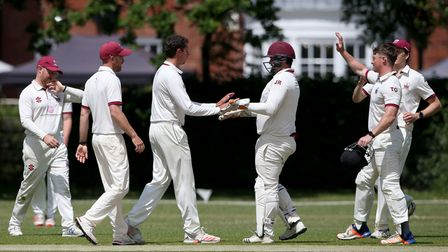 Charlie Griffiths of Brentwood celebrates with his team mates after taking the wicket of Shahbaz Kha