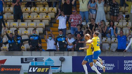 Goal celebrations for Dean Moxey of Torquay United during the National League Semi Final Play Off ma