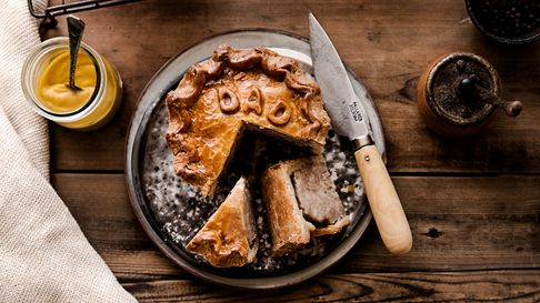 Pork Pie with withe words DAD in pastry