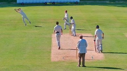 Jim Keys takes a brilliant catch off the bowling of Corey Fox for Waresley at Flitwick