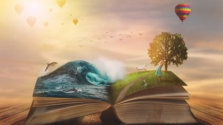 Concept of an open magic book; open pages with water and land and small child. Fantasy, nature or le