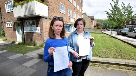 Residents Emily and Annie Arkell in front of the grass area proposed for Creative Explorers Day Nursery