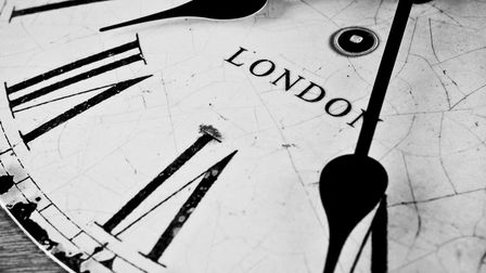 Cracked and weathered old black and white clock face, multiple concept use, banking, financial, time