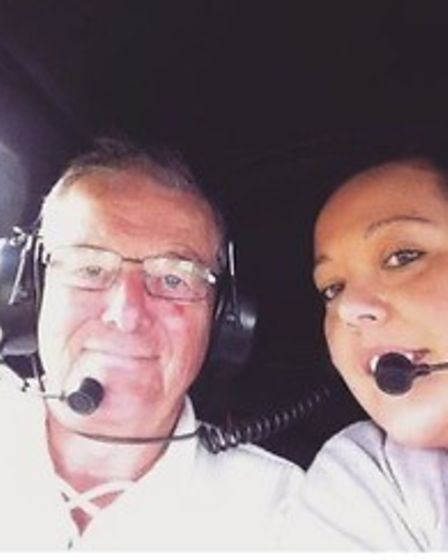 Laurawith her dad Denison a helicopter ride.