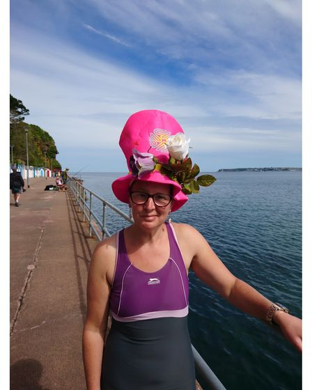 Woman swimmer in floral hat