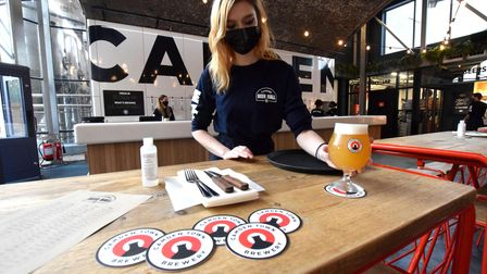 A masked-up server at Camden Town Brewery's new Beer Hall