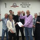 Celebratory scenes at Portishead Football Club with members of the club's committee and councillors.
