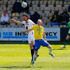 Scott Boden of Torquay United challenges for the aerial ball with Ben Nugent of Barnet during Torquay United v Barnet