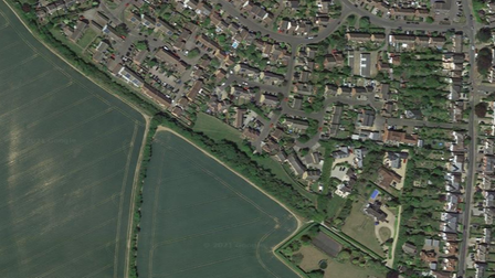 A bird's eye view image of Saffron Walden. In the centre, a different shade of green: the lawn earmarked for development
