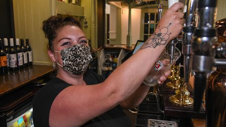 Natalie Pearce, bar staff at The Woodman pub on North Walsham Road in Norwich which has re-opened. P