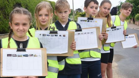 Horsford Primary School children doing a traffic survey, who have started an online petition for a