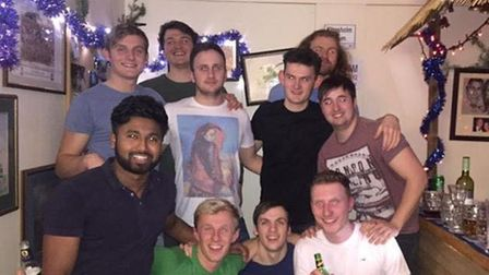 Tom pictured with his friends, who will be climbing Scafell Pike in August in his memory.