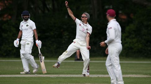 Ian Belchamber in bowling action for Brentwood during Brentwood CC (bowling) vs Harold Wood CC, Hamr