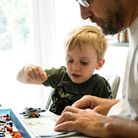 Jack builds some lego with his Dad, at home during his second week of school closures due to the cor