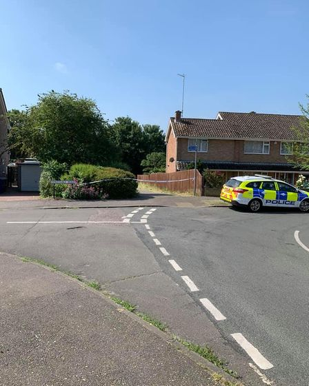 Police cordon and two police cars at Constable Road in Bury St Edmunds