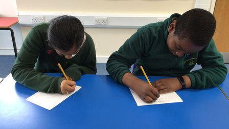 Some pupils at Newton's busy writing their Father's Day messages