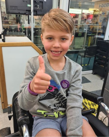 Six-year-old Hudson Streatfield, who attendsArdeley St Lawrence Primary, gave a big thumbs up after his hair transformation